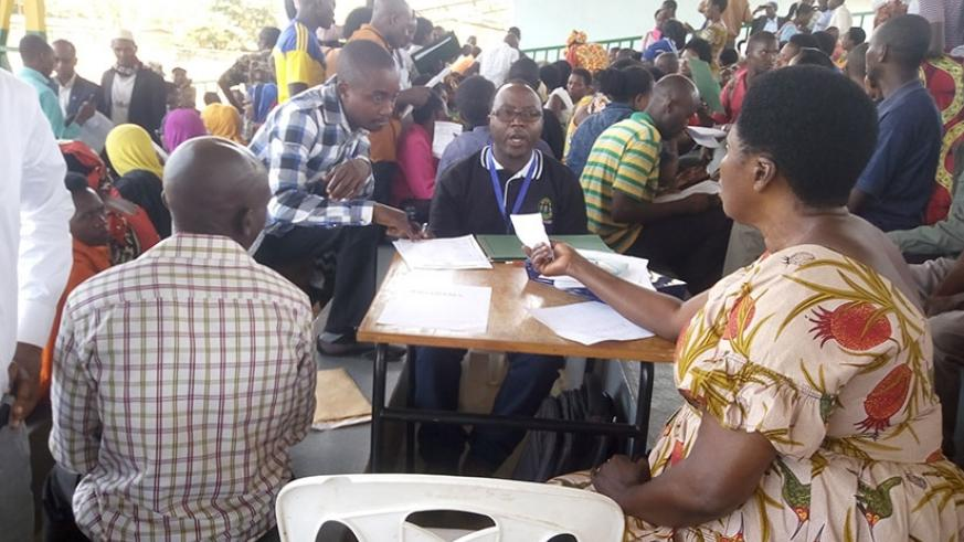 People engage a land official (C) during the Land Week. (Jean d'Amour Mbonyinshuti)