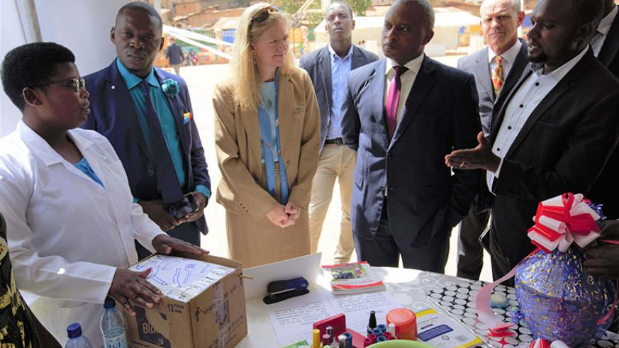 The US Ambassador to Rwanda, Erica Barks-Ruggles, and the Minister of State in charge of Technical and Vocational Education and Training, Olivier Rwamukwaya, during an exhibition of various courses that will be provided through Huguka Dukore project at the launch in Kigali yesterday. (Courtesy photos)