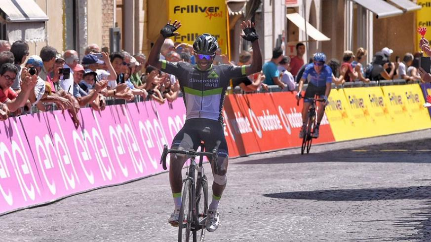 Joseph Areruya raises his arms in the air in celebration after winning stage five of Giro d'Italia yesterday. (Courtesy)