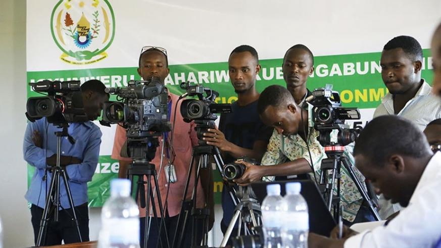 Local media practitioners cover a past event. (Sam Ngendahimana)