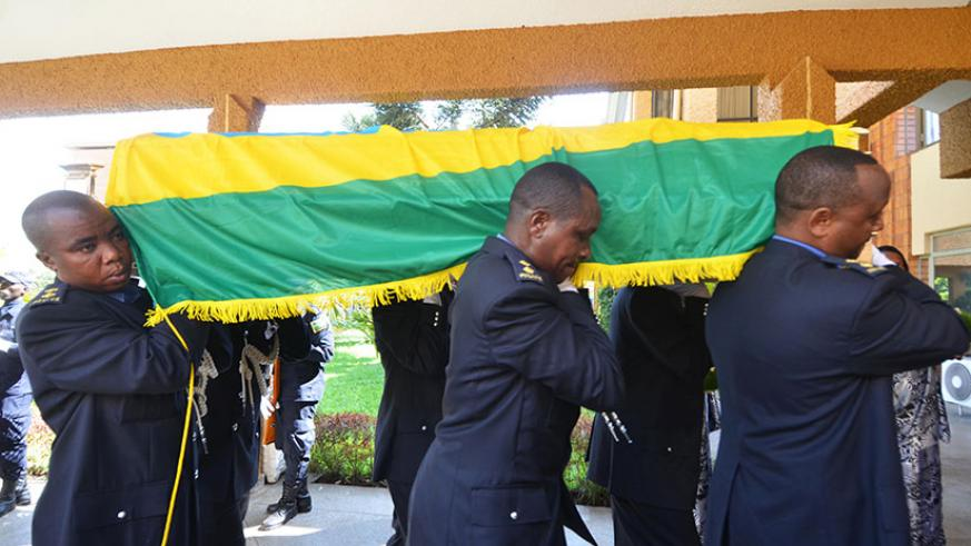 Police officers carrying the body of the deceased MP as they make an entrance to Parliament where she was honoured for her service to the country. / Sam Ngendahimana