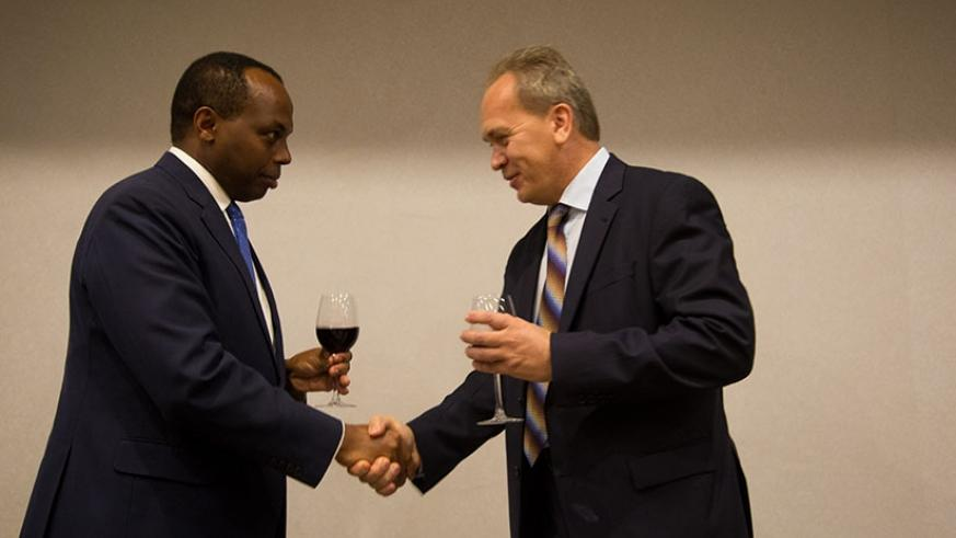 Gatare (L) and Dr Nikitin toast during the event in Kigali. (Timothy Kisambira)