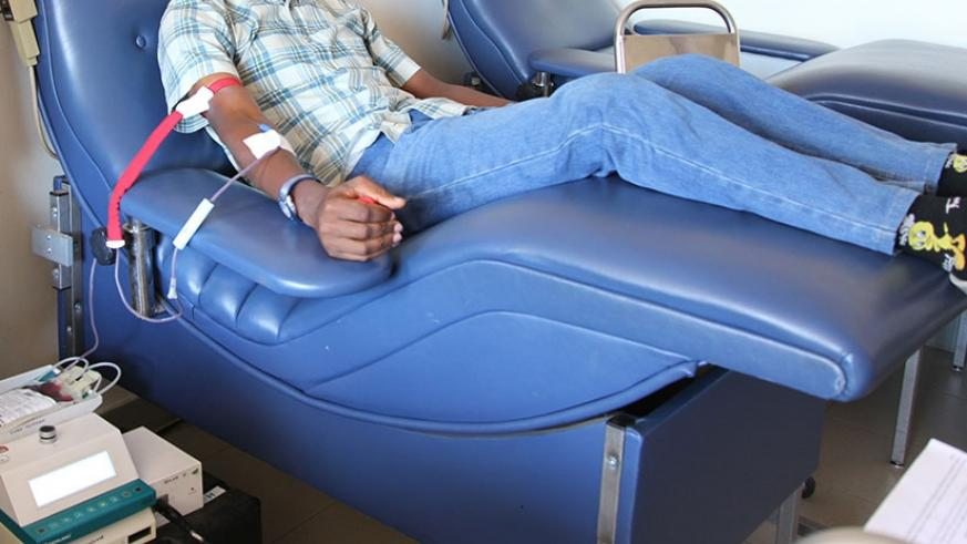 A man donates blood during a past blood donation awareness drive in Kigali. (File)