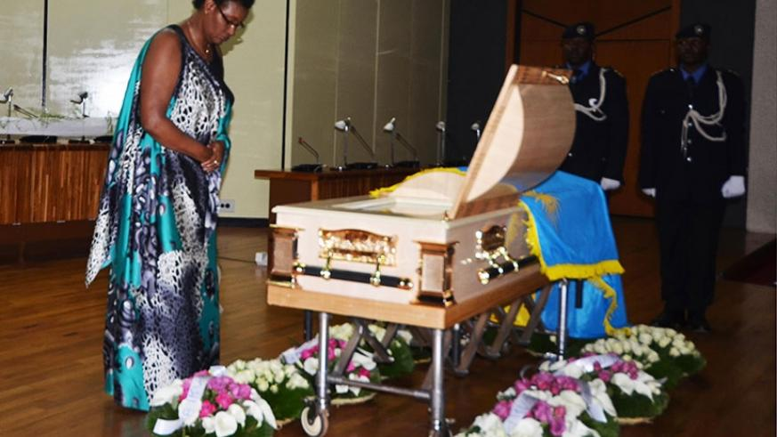 Speaker Mukabalisa pays her last respects to the Late Mukayisenga at Parliament yesterday. (All photos by Sam Ngendahimana)