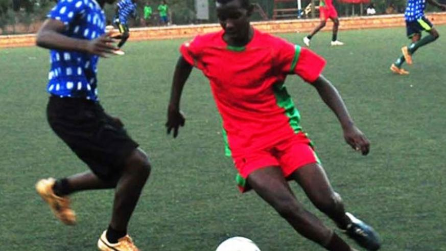 Kagarama secondary school (in red) beat NFF team 2-0 in the final. (F. Byaruhanga)
