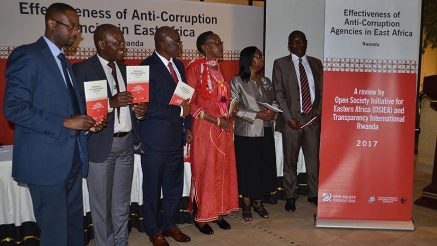 Officials at the launch of the study findings yesterday. Steven Muvunyi.