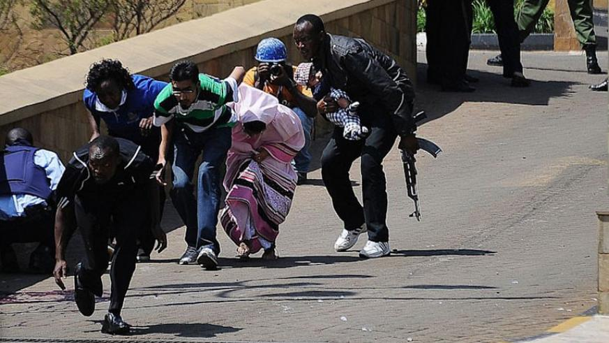 Police and security operatives lead hostages out of Westgate shopping mall in Nairobi during a terrorist attack in 2013. Net