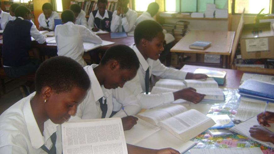Students revise using textbooks. REB has recalled a textbook that trivialises Genocide. / File