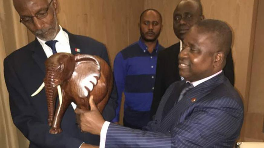 RPF-Inkotanyi secretary-general Francois Ngarambe (L) exchanges a gift with Pierre Ngolo, the secretary-general of Parti Congolais du Travail (Republic of Congo) in Kigali yesterda....
