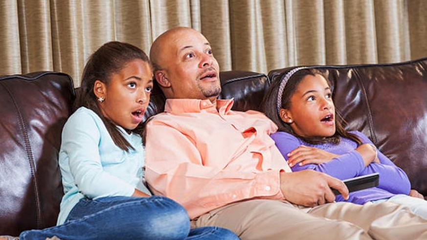 Watching TV and doing other things together as a family helps break the monotony that comes with curfews  (Net photo)