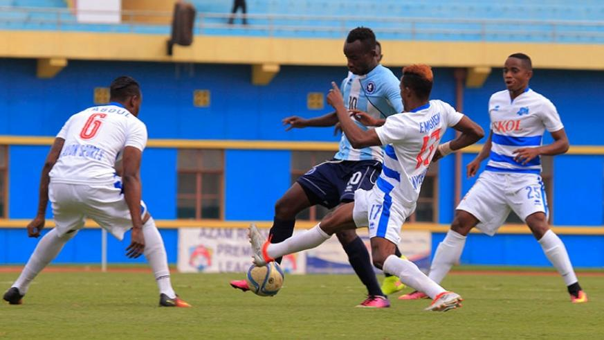 Police striker Danny Usengimana tries to dribble past Rayon players during a recent league game. (Sam Ngendahimana)