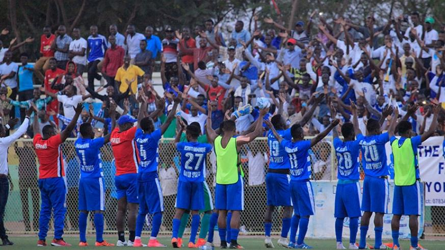 Rayon Sports players join fans in their legendary clap celebration after holding APR to a one-all draw at Stade de Kigali in May. (Sam Ngendahimana)