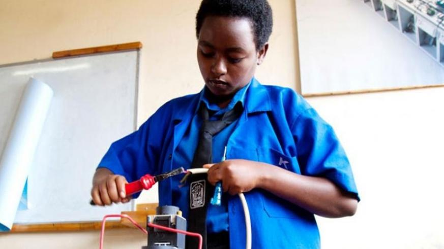 A TVET student runs a demo on how her project operates during a past exam. (File)