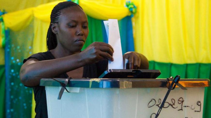 A citizen casting her vote during a past election. / File