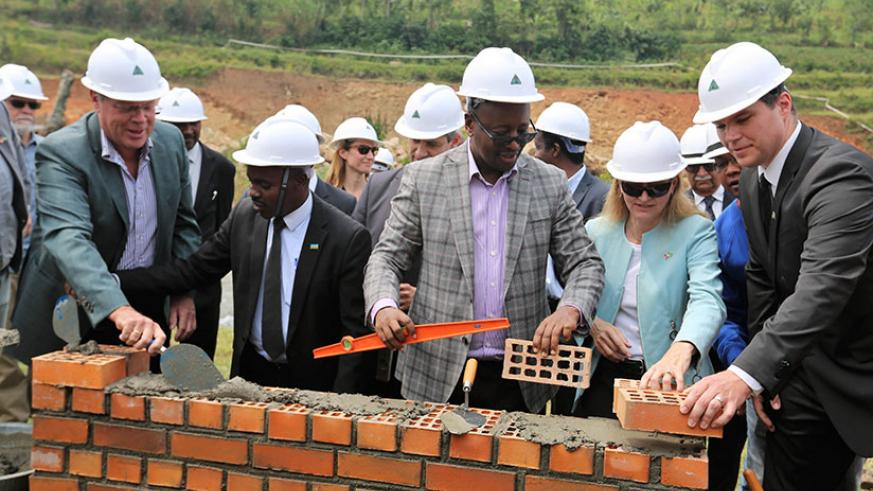 Minister Musoni (C) with Amb. Barks-Ruggles and German Ambassador to Rwanda Peter Woeste, among other officials, during the groundbreaking event in Musanze. / Courtesy