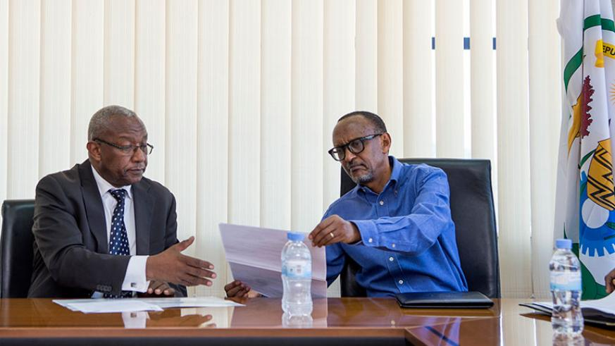 President Kagame presents his candidature documents to the National Electoral Commission chairperson, Kalisa Mbanda, yesterday. Addressing local and international media after the e....
