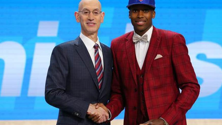 Frank Ntilikina (R) after he was drafted to the NBA (Net photo)