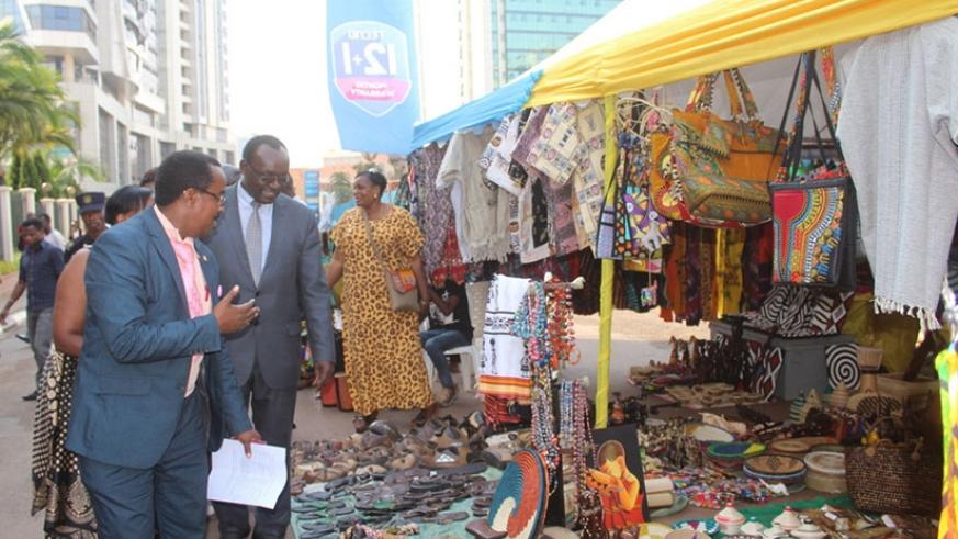 Minister Kanimba (middle) and city officials inspect the exhibition yesterday. / Francis Byaruhanga.