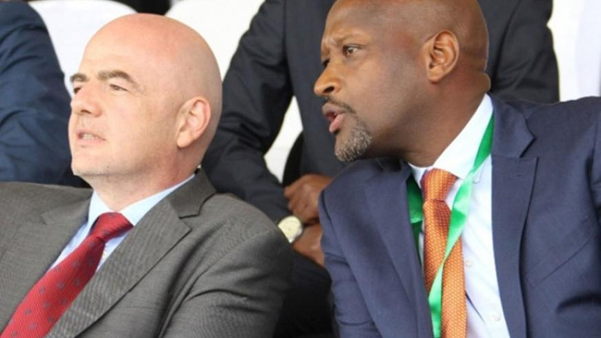 Nzamwita with FIFA boss Infantino when the latter visited Rwanda in February. File