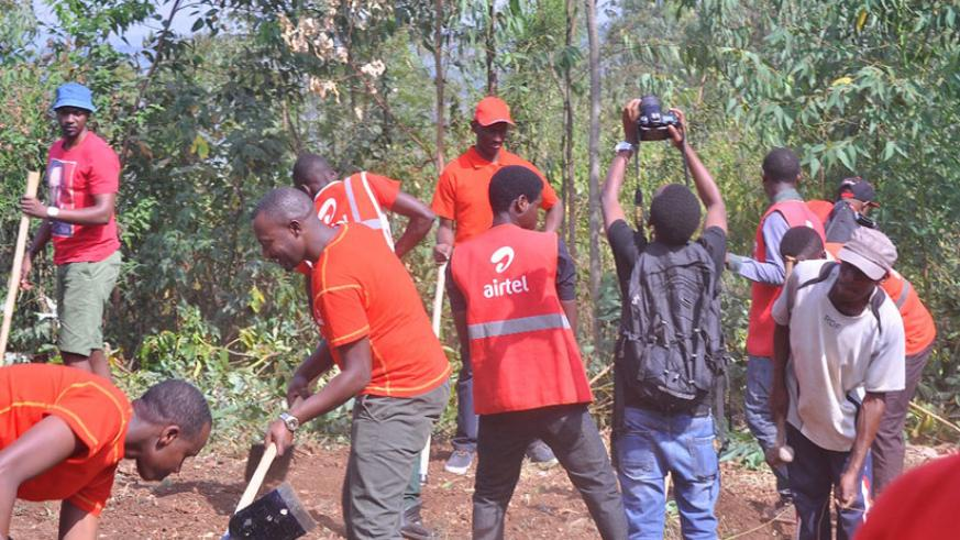 Some of the Airtel Rwanda staff who participated in the communal work on Saturday. / Appolonia Uwanziga