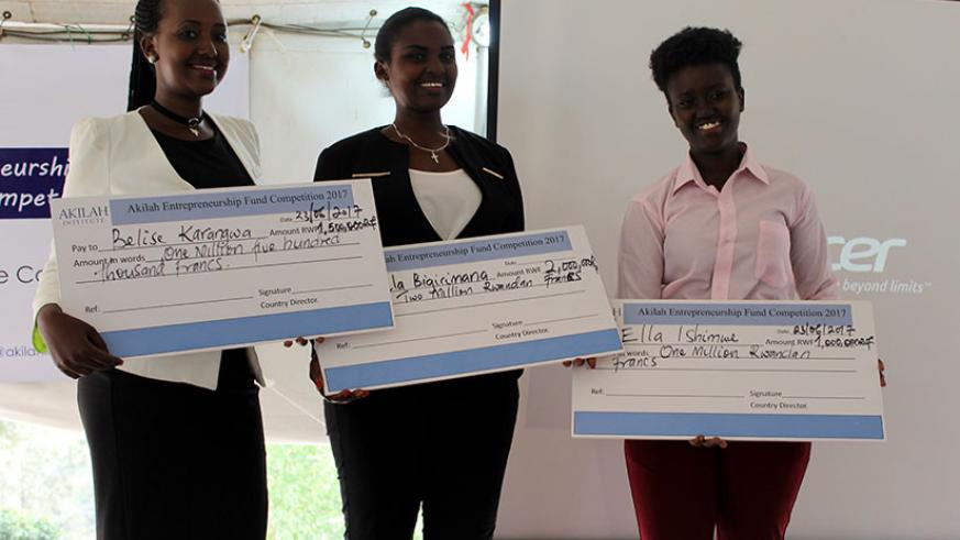 The winners pose with dummy cheques for their cash prizes. / Francis Byaruhanga