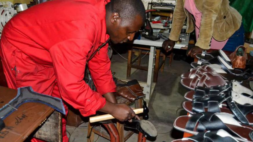 Micheal Habumugisha from Musanze in his workshop making leather products. The government has been promoting 'Made-in-Rwanda' products to boost local industries. / File