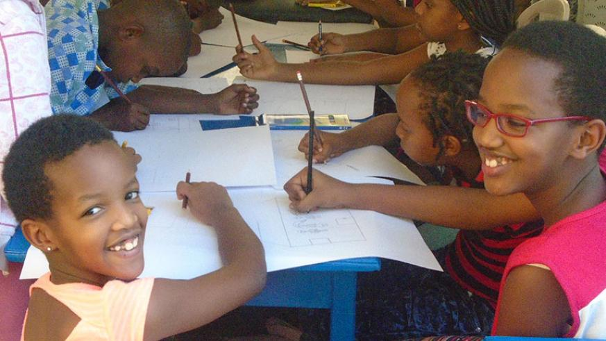 Pupils drawing during the competition. (Lydia Atieno)