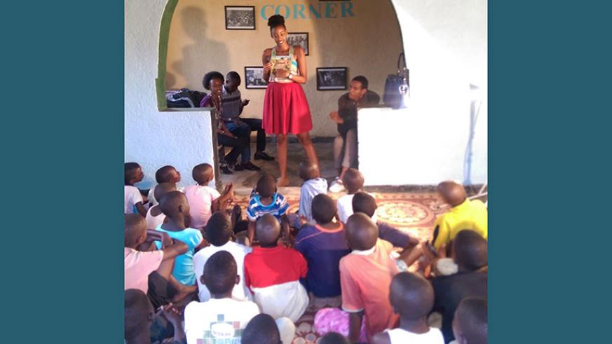 Children books author Peace Kwizera reads one of her books to the children. Learning is the foundation of good ideas. (Dennis Agaba)
