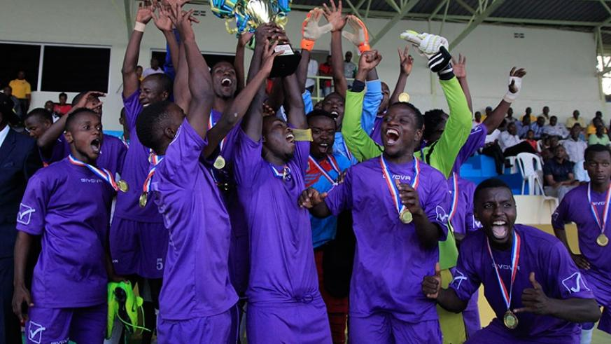 Miroplast FC players hold their trophy aloft after beating Isonga FC 2-0 on Monday. (Sam Ngendahimana)