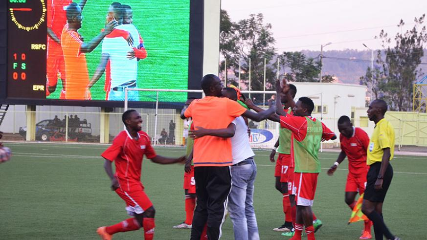 Jimmy Ndizeye, Espoir FC head coach seen here celebrates with his players after shocking Rayon Sports (All photos by Sam Ngendahimana)