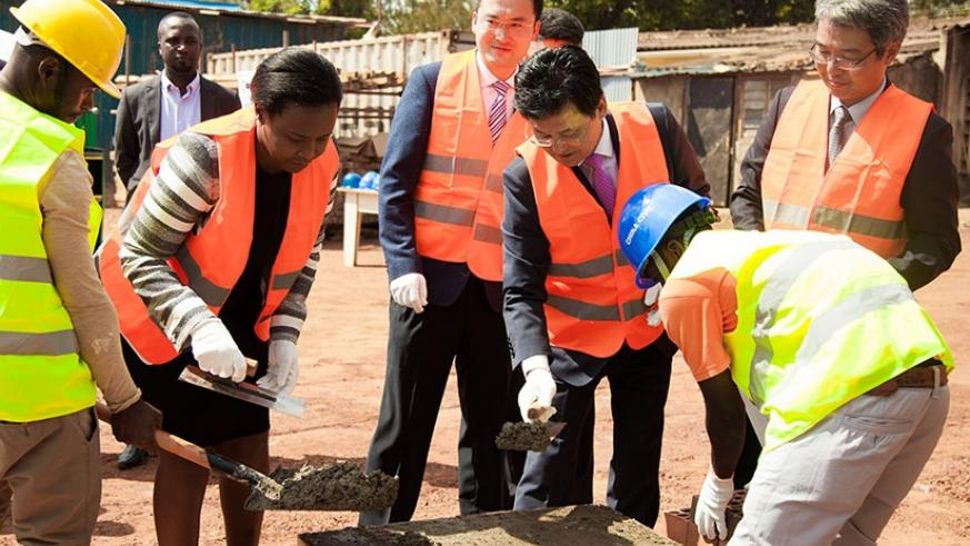 RDB's Akamanzi and Amb. Kim Eung Joong lay the foundation stone for the ICT Innovation centre in Kigali. (Nadege Imbabazi)