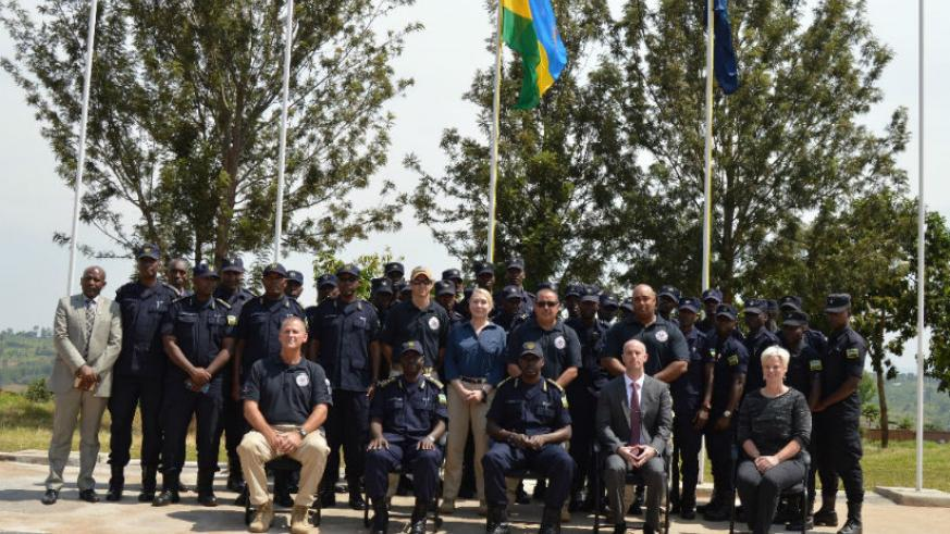 DIGP Dan Munyuza and other officials in a group photo with officers who completed the VIP Protection ToT course. / Courtesy