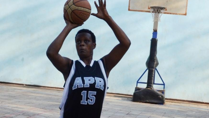 APR women basketball club captain Charlotte Umugwaneza tries a free-throw in a recent league match (Sam Ngendahimana)