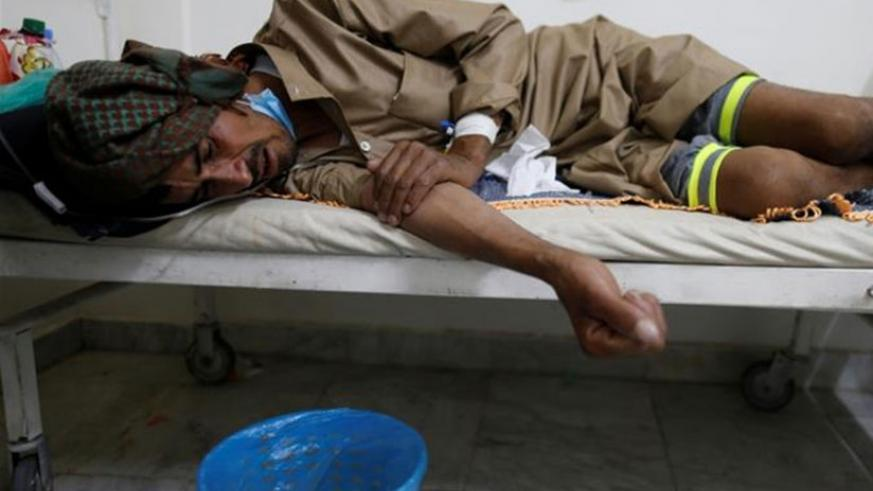 A man lies on the bed of a cholera treatment center in Sanaa, Yemen. Net photo.