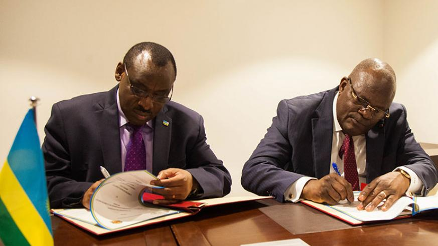 Finance and Economic Planning minister Claver Gatete and Republic of Congo minister for finance and budget, Callixte Nganongo, sign an agreement establishing a framework under whic....