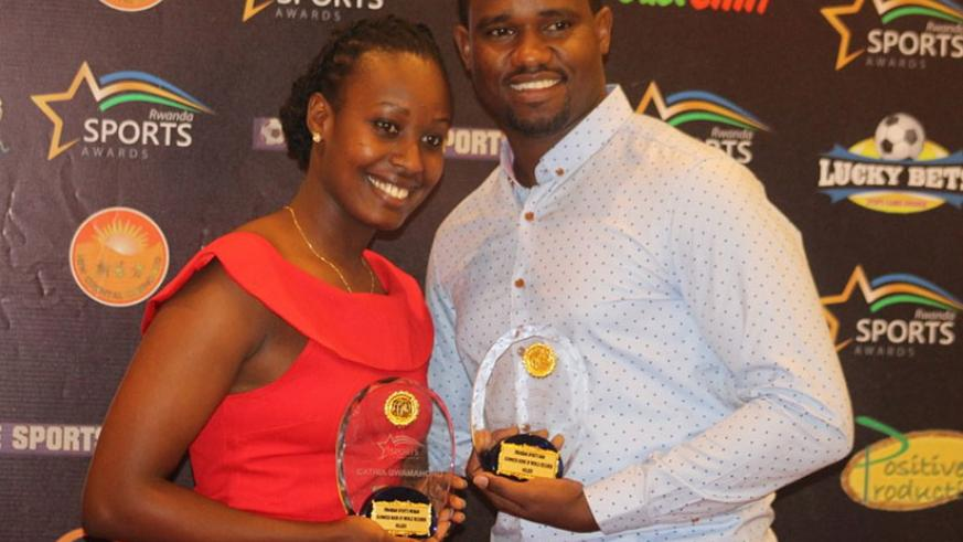 Cricket duo of Carthia Uwamahoro and Eric Dusingizimana were given special recognition awards for setting world records for longest time batting. / Courtesy