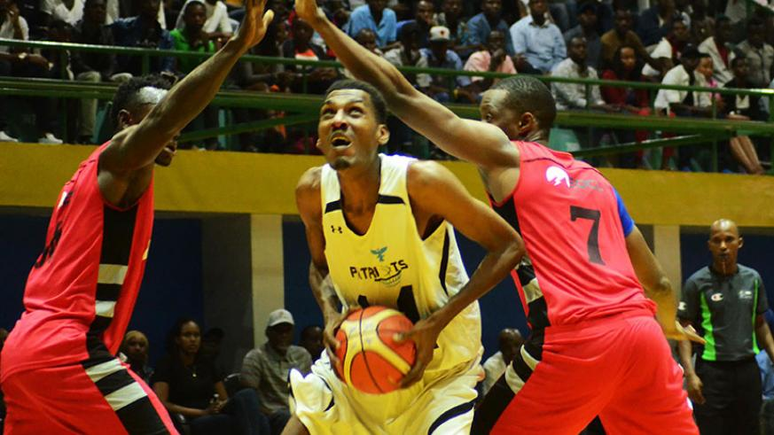 Patriots' centre player Jean de Dieu Ntagunduka tries to drop two points as two REG players try to block him in a recent league match. / Sam Ngendahimana