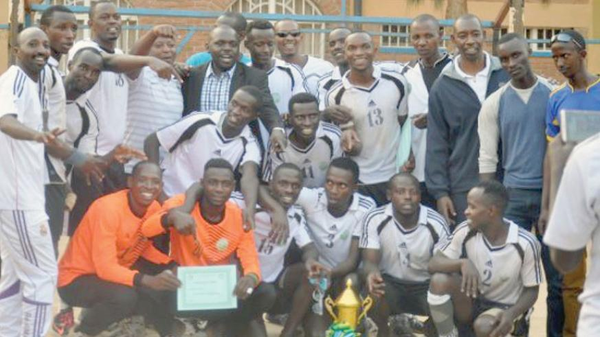 APR players and coaching staff in a group photo with the trophy after winning the Carre d'As title on Monday at Kimisagara ground. (Courtsey)