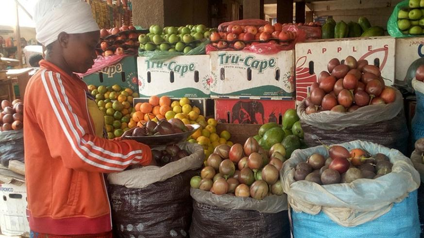 Consumers now have to dig deeper into their pockets to buy fruits. )Remy Niyingize)