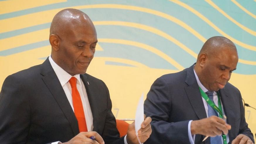 Elumelu (left) and Dr Benedict Oramah, the chairman of Afreximbank, sign a deal for $100 million credit facility to support Heirs Holdings. (Julius Bizimumgu)