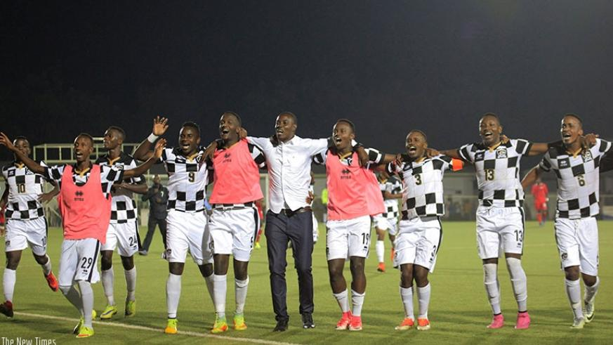 APR FC head coach Jimmy Mulisa and his players celebrate after winning the club's ninth Peace Cup title at Stade de Kigali on Tuesday. (Sam Ngendahimana)