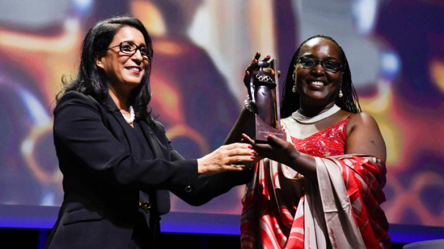 RNOSC Vice president Felicite Rwemalika was awarded the IOC Women and Sport Africa Trophy by the IOC president, Thomas Bach. / Courtesy