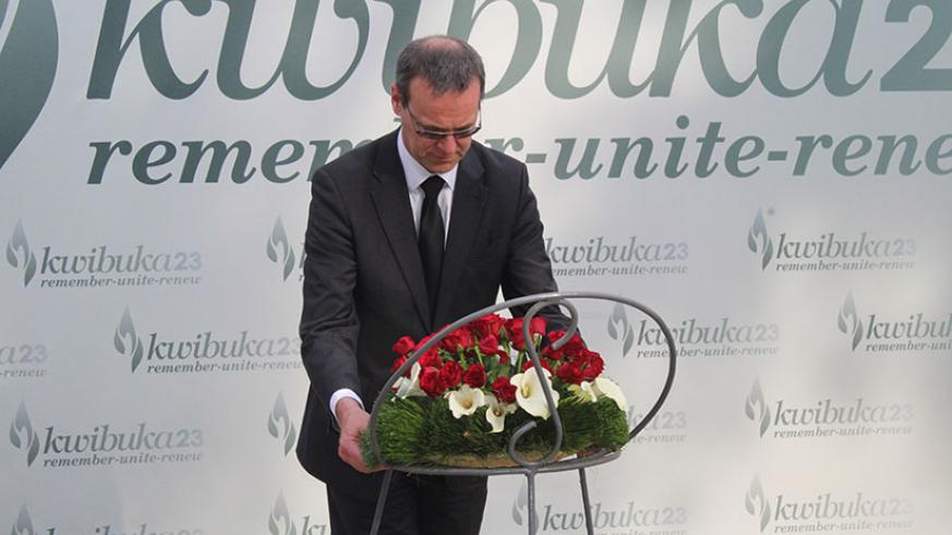 Sir McDonald lays a wreath at the Kigali Genocide Memorial. / Courtesy