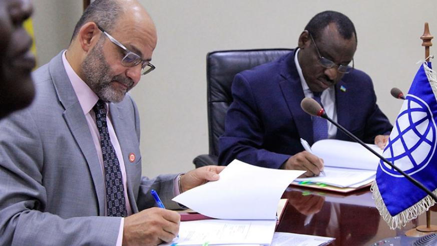El-Gammal and Minister Gatete sign the agreement in Kigali yesterday. Sam Ngendahimana.