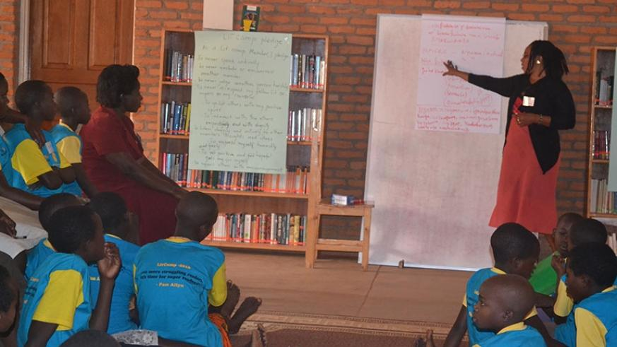Students listen to a teacher in class. Parent's involvement in the child's activities at school boosts self-esteem and overall academic achievement.  (Photos by Lydia Atieno)
