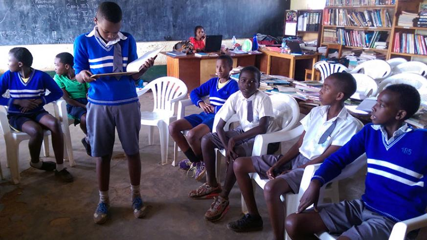 Reading aloud. A pupil reads out to his colleagues during a reading class. (All photos by Dennis Agaba)