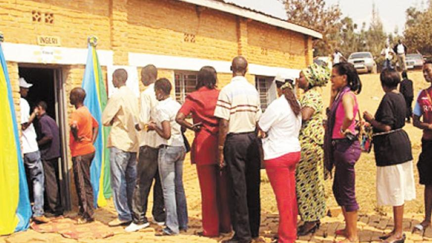Rwandans exercise their right to vote during  past elections.  (File)