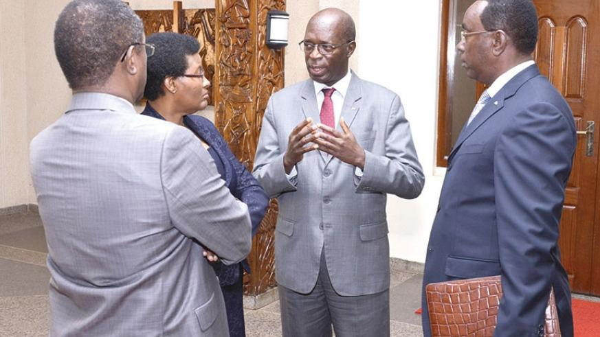 Prime Minister Anastase Murekezi chats with Speaker of the Chamber of Deputies Donatille Mukabalisa (2nd L), Natural Resources minister Vincent Biruta (L), and Senate president Ber....