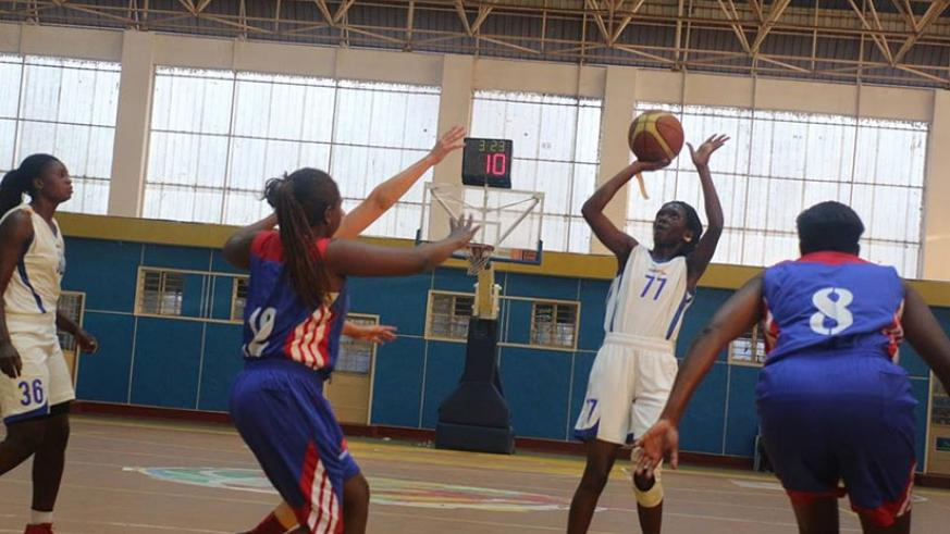IPRC-South point guard Sandra Nelly Nsanzabaganwa shoots as Ubumwe players try to block her during the semi-finals two weeks ago at Amahoro Indoor Stadium. (Courtesy)