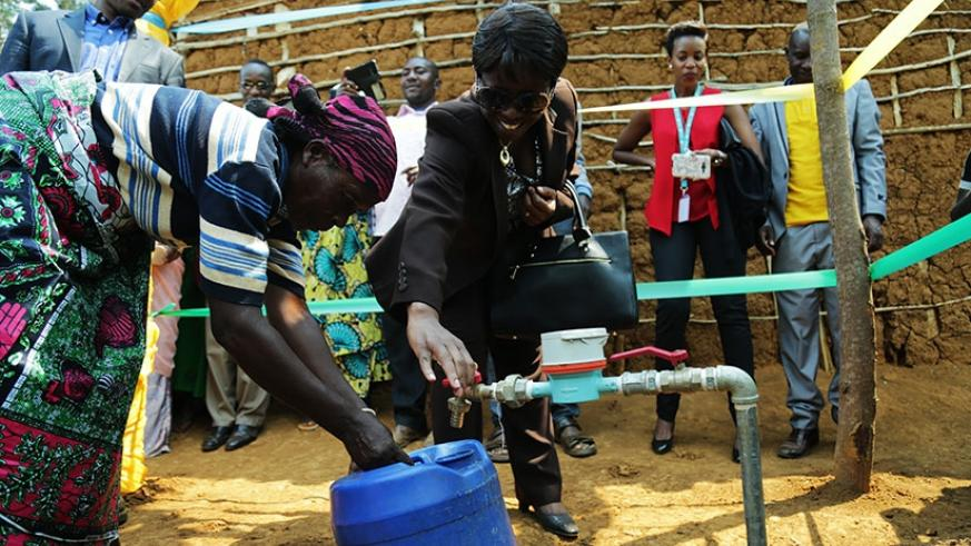 Minister Kamayirese launches the new water project in Nkombo Island in Rusizi District yesterday. (Timothy Kisambira)